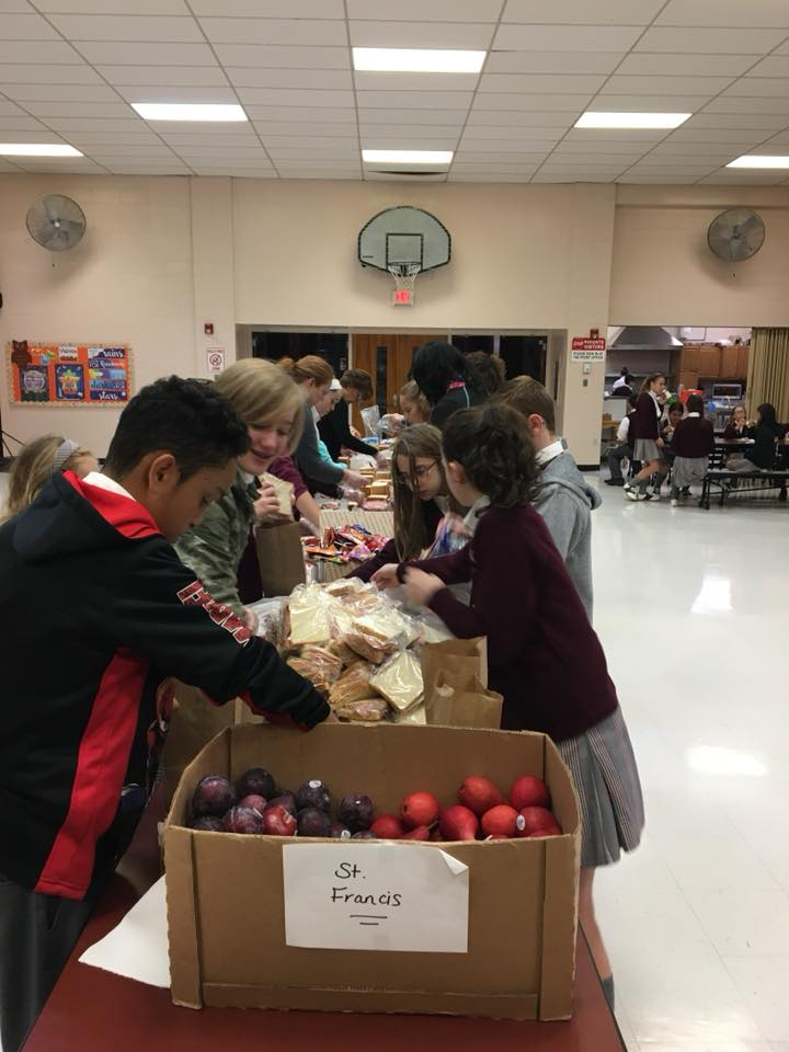 Students making lunches for homeless
