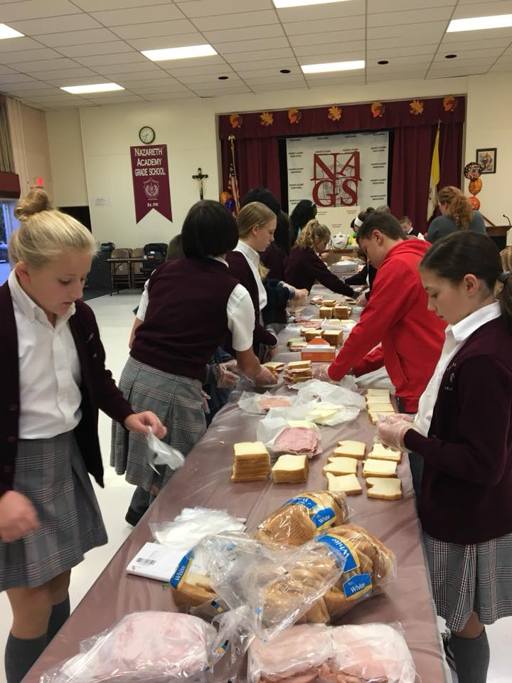 students making lunch for the homeless