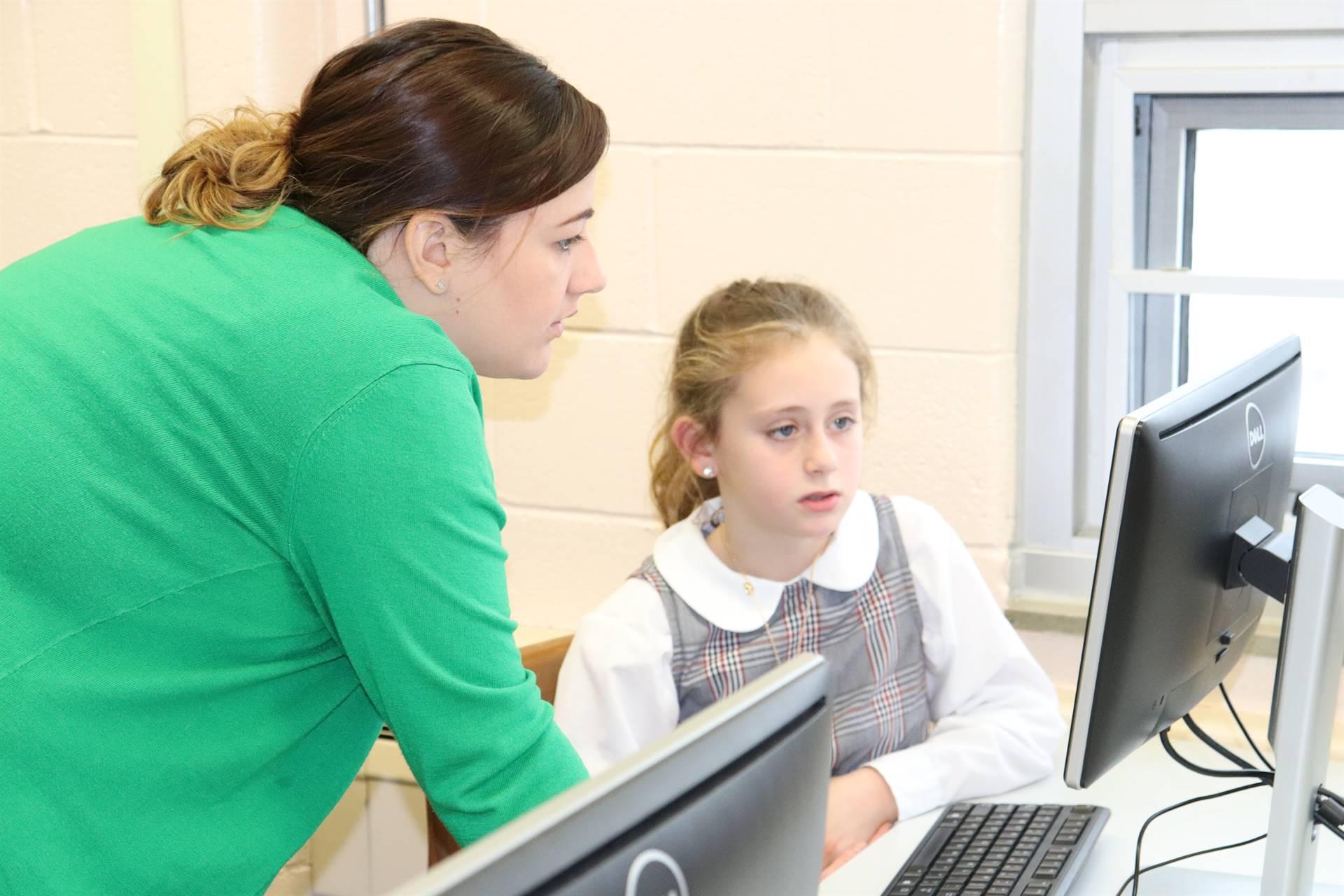 Student and teacher in Tech class