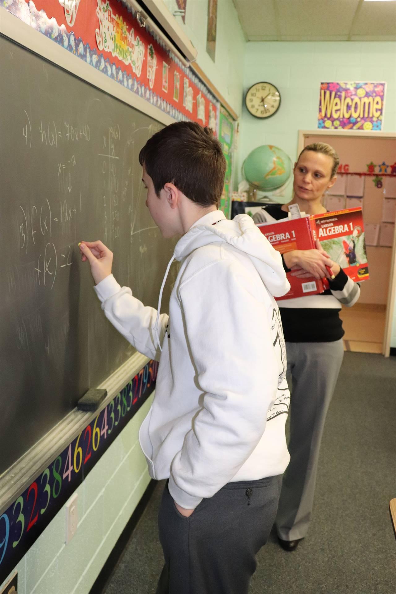 Student and Teacher in Math class