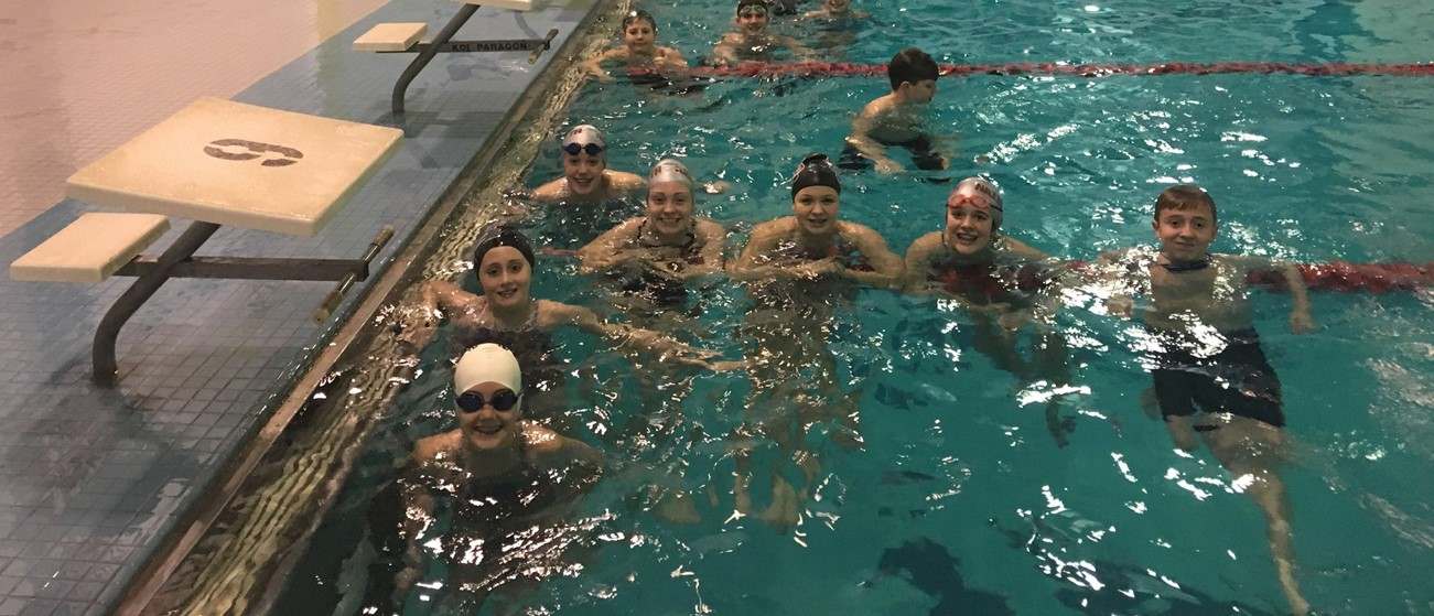Swim meet students in pool