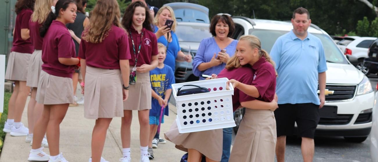 Students hug on back to school